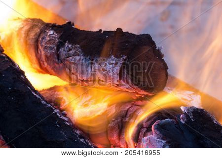 burning charcoal in the background . Photo of an abstract texture