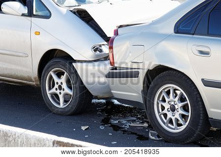 Two cars in a car accident on street. Closeup damaged automobiles after collision in city. Insurance case.