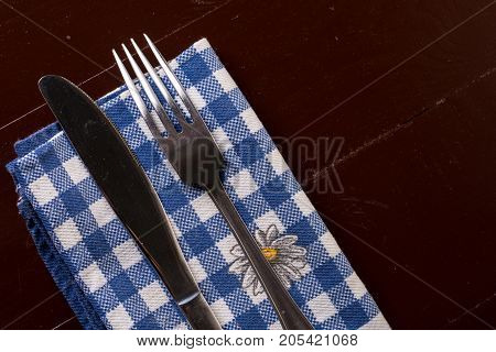 Flat Lay Above Silverware, Metal Fork And Knife On The Kitchen Dishcloth On The Table With Copy Spac