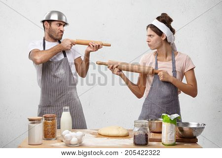 Two Female And Male Competitors Struggle For Winning Culinary Contest, Target At Each Other With Rol