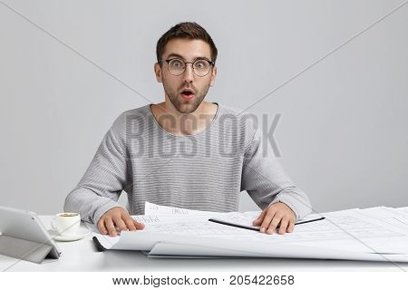 Puzzled Surprised Young Office Worker Realizes His Fault, Doesn`t Want To Create Construction Plan F