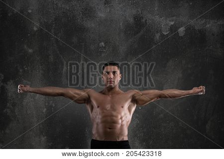 Body building trainer shows his power muscles
