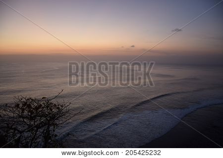 Amazing sunset at Uluwatu hindu temple on the sea in Bali, Indonesia