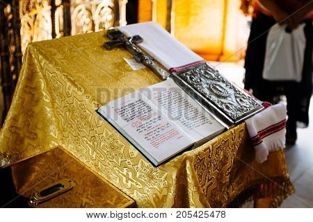 Sacred Lectern In The Church Decorated With Golden Friezes And Ornaments, Church Interior With Bible