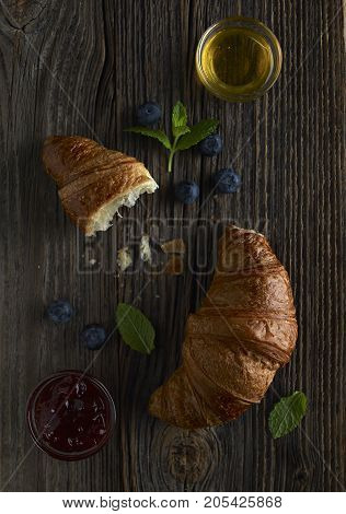 Delicious breakfast with fresh croissant and coffee.