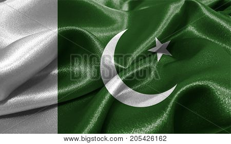 Realistic flag of Pakistan on the wavy surface of fabric. This flag can be used in design