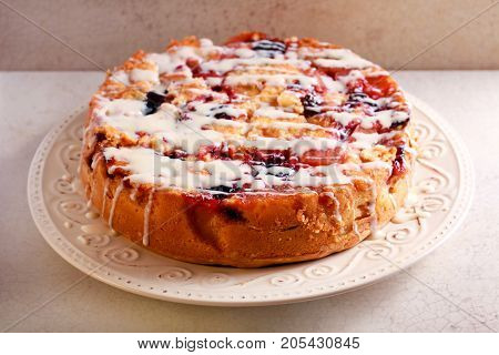Mixed fruit cake with icing drizzle over
