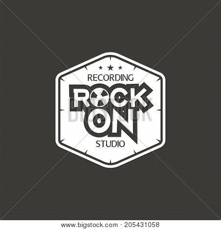 Rock on. Recording studio vector label, badge, emblem logo with musical instrument. Stock vector illustration isolated on dark background.