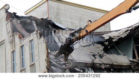 Long Arm of a Demolition Machine Grabbing Concrete.
