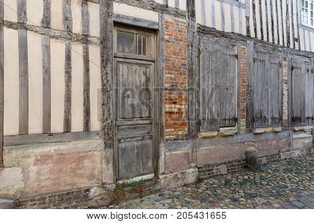 Passage with old medieval houses downtown in Honfleur France