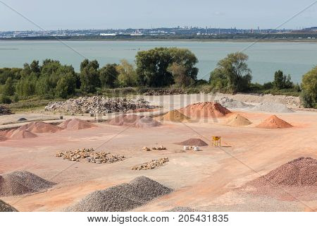 Stockyard of quarries sands pebbles and aggregates along river Seine near Le Havre France