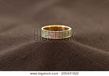 Close up of elegant diamond ring with cloth background