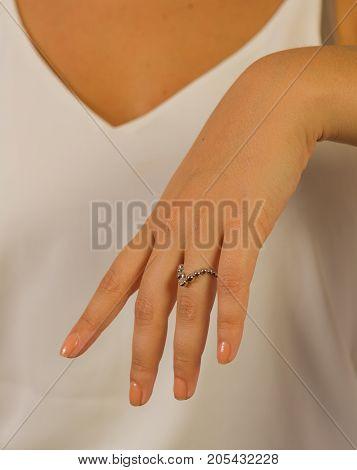 close up of a beautiful woman wearing a diamond ring