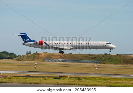 Copenhagen - August 2013: Sas Bombardier Crj-909Er Airplane Landing At Copenhagen Airport In Denmark