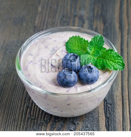 Cream cheese and blueberry mousse in a glass square format