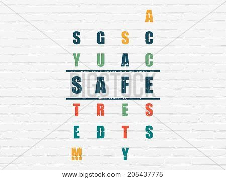 Privacy concept: Painted blue word Safe in solving Crossword Puzzle