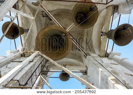 A number of different-sized bells in the Prepodobenskaya bell tower of the Rizopolozhensky female monastery. Suzdal, Golden Ring, Russia