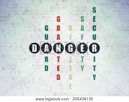 Safety concept: Painted black word Danger in solving Crossword Puzzle on Digital Data Paper background