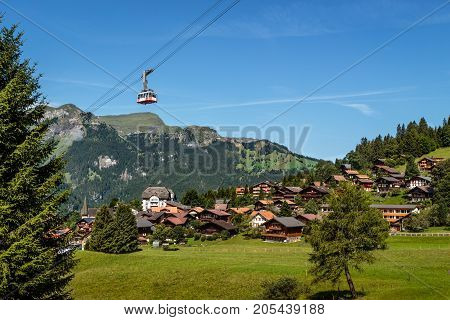 Aerial cableway over car free mountain village Wengen in the Bernese Alps on a sunny day in summer. Wengen Bernese Oberland Switzerland