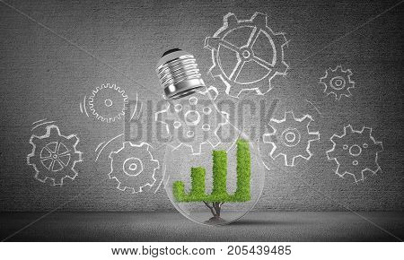 Lightbulb with growing green graph inside placed against sketched gear mechanism on grey wall on background. 3D rendering.