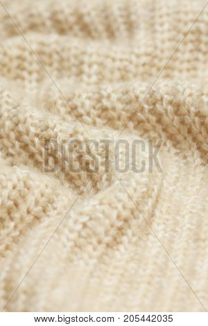 background drapery knitted beige cloth close up
