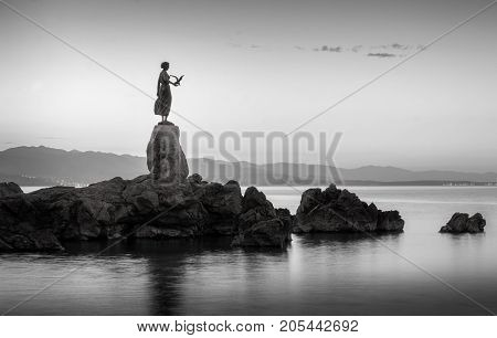 Well known statue of a girl holding a seagull in Opatija Croatia