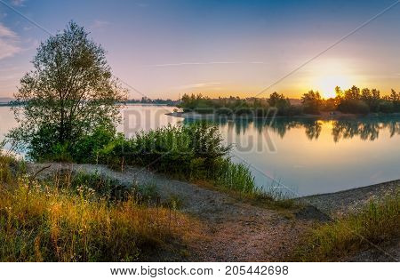 First sunlight touches surface of the lake Cice in Velika Gorica near Zagreb Croatia poster