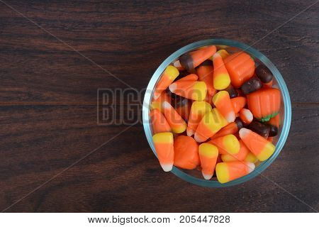 glass bowl of candy corn on table