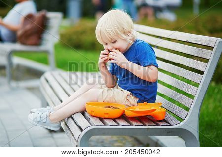 Little Boy With Lunchbox And Healthy Snack