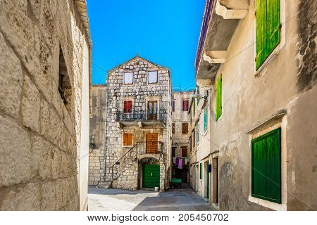 View at old medieval streets in Komiza place, Island Vis scenery.