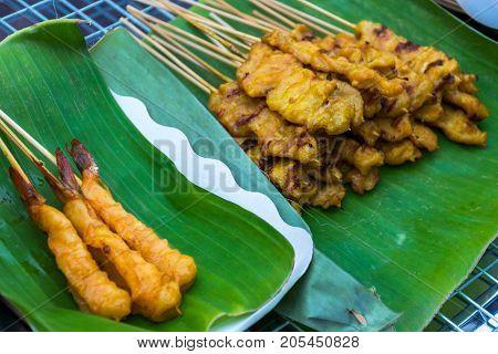 Shrimp satay and prok satay (Thai food style)