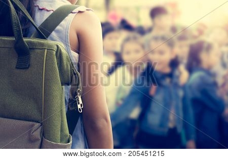 Girl with backpack attend school activities Education concept.