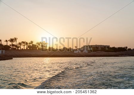 Sunset in the city of El Gouna. Waves on the water.
