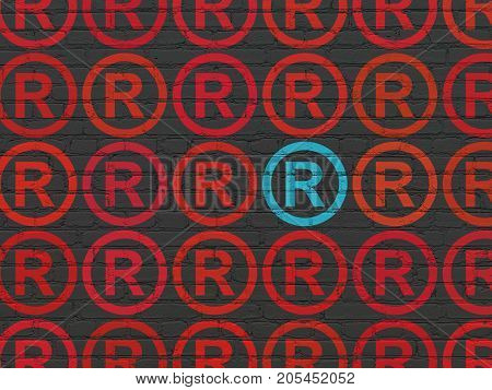 Law concept: rows of Painted red registered icons around blue registered icon on Black Brick wall background