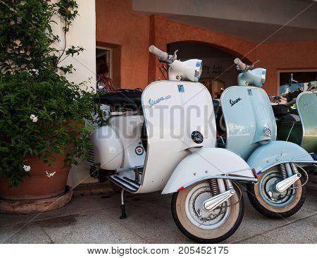 Porto Cervo, Italy - August 18, 2017: Piaggio Vespa and lambretat vintage sprint motor scooter motorbike motorcycle