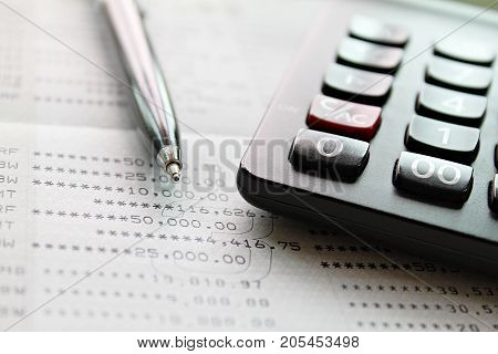 Business, finance, savings, accounting or loan concept : Calculator and pen on saving account passbook or financial statement