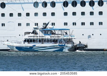 Bar Harbor Maine USA - 28 July 2017: The King Bay III of the Bar Harbor Whale Watch Company picking up passengers on a cruise ship for a whale watching nature tour.