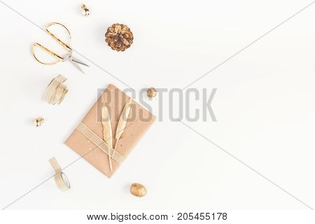 Christmas composition. Christmas gift pine cone golden accessories on white background. Flat lay top view copy space