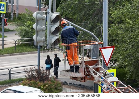 Installation of a traffic light on a lift in the afternoon in the city of Syzran Russia.