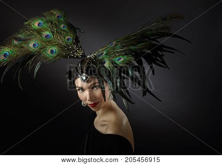 Woman In Retro Style With Feather Headdress.