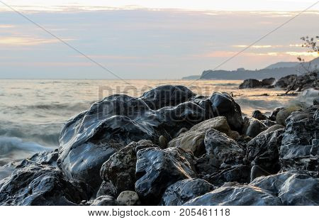 wet stones on the shore, stones on sea coast, black stones, black stone, seascape