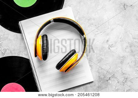 Compose music. Vinyl records, headphones, music notes on grey background top view.