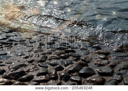 The water of the river Neva washes the stones of the base of Peter-Paul Fortress Fortress in Saint Petersburg, Russia. Backlighting