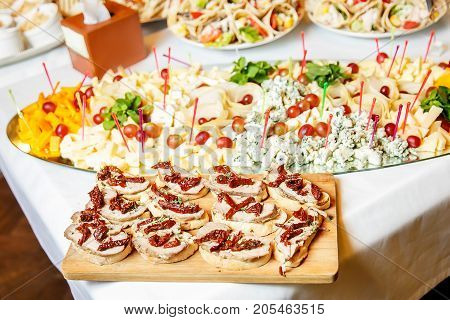 Meals for gourmets, cheese plate on the event catering