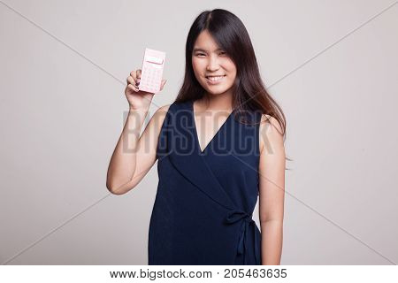 Asian Woman Smile With Calculator.