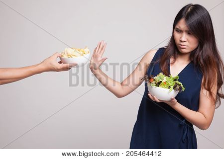 Young Asian Woman With Salad Say No To Potato Chips.