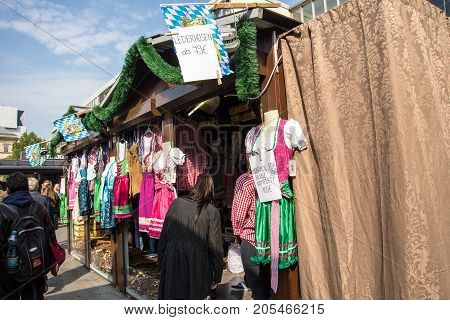 MunichGermany-September 242017: Arriving tourists can buy traditonal bavarian costumes at a quiosque outside Munich Central Station