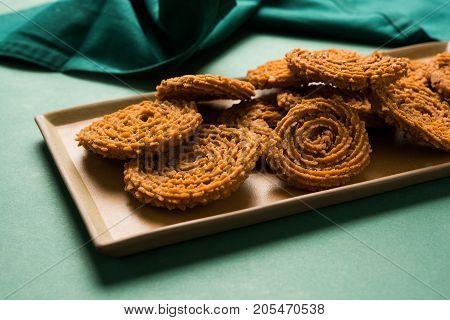 Stock Photo of Chakli or Chakali or Murukku, popular salty food made during diwali festival