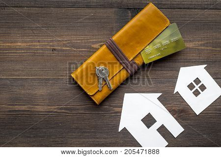 purchasing house set with online card payment on work desk wooden background top view mock up