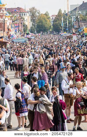 MunichGermany-September 242017: Crowds walk on the Oktoberfest grounds .
